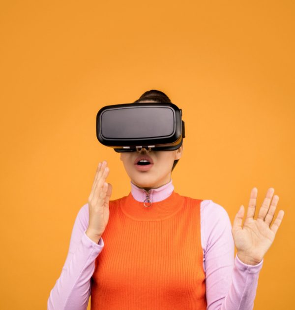 woman-in-long-sleeve-shirt-experiencing-virtual-reality-3761299